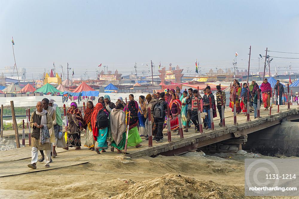 Pilgrims crossing the Ganges river on a temporary pontoon bridge, Allahabad Kumbh Mela, Uttar Pradesh, India
