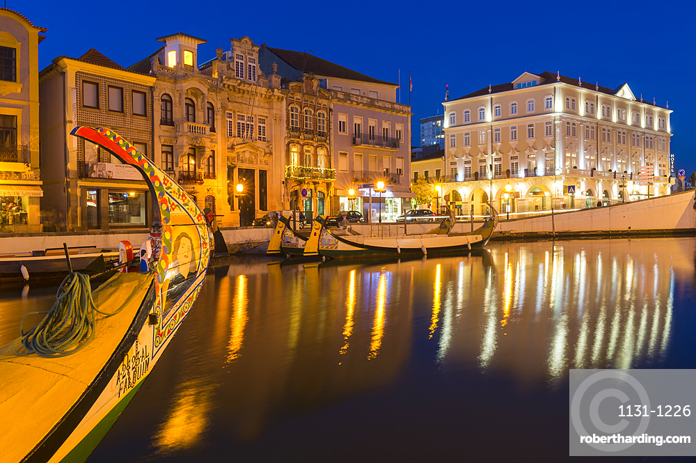 Moliceiros moored along the main canal at sunset. Aveiro, Venice of Portugal, Beira Littoral, Portugal