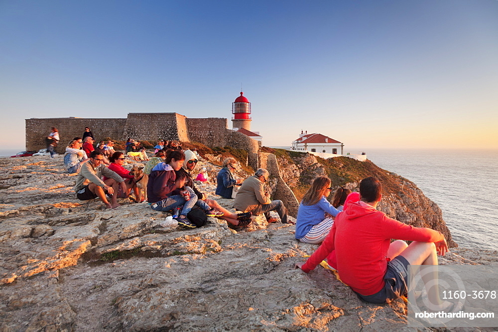 Tourists enjoying sunset at the lighthouse at Cabo de Sao Vicente, Sagres, Algarve, Portugal, Europe