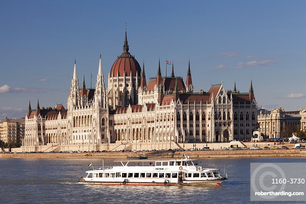 Excursion boat at Danube River, Parliament Building at sunset, Budapest, Hungary