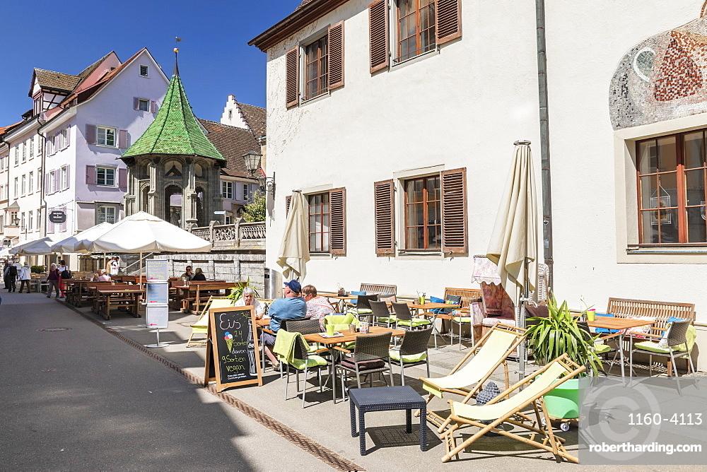 Street cafe on pedestrian area Munsterstrasse, Oelbergkapelle Chapel in the back, Uberlingen, Lake Constance, Baden-Wuerttemberg, Germany