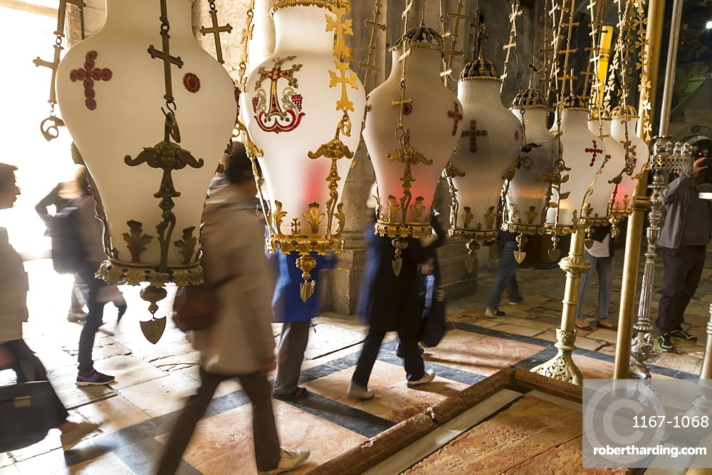 Pilgrims pass the Stone of Unction, Church of the Holy Sepulchre, Old City, Jerusalem, UNESCO World Heritage Site, Israel, Middle East