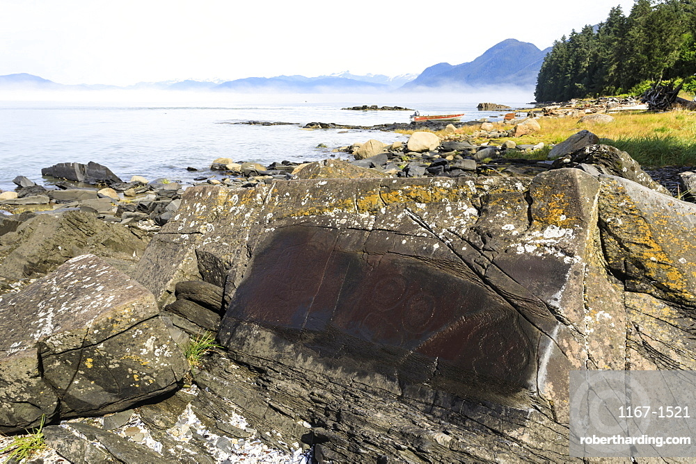 Petroglyphs with mist clearing from beautiful Petroglyph Beach, State Historic Park, Wrangell, Inside Passage, Alaska, United States of America, North America