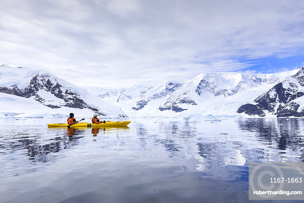 Kayakers in spectacular mountain and glacial scenery, reflections of Neko Harbour, Anvord Bay, Antarctic Continent, Antarctica, Polar Regions