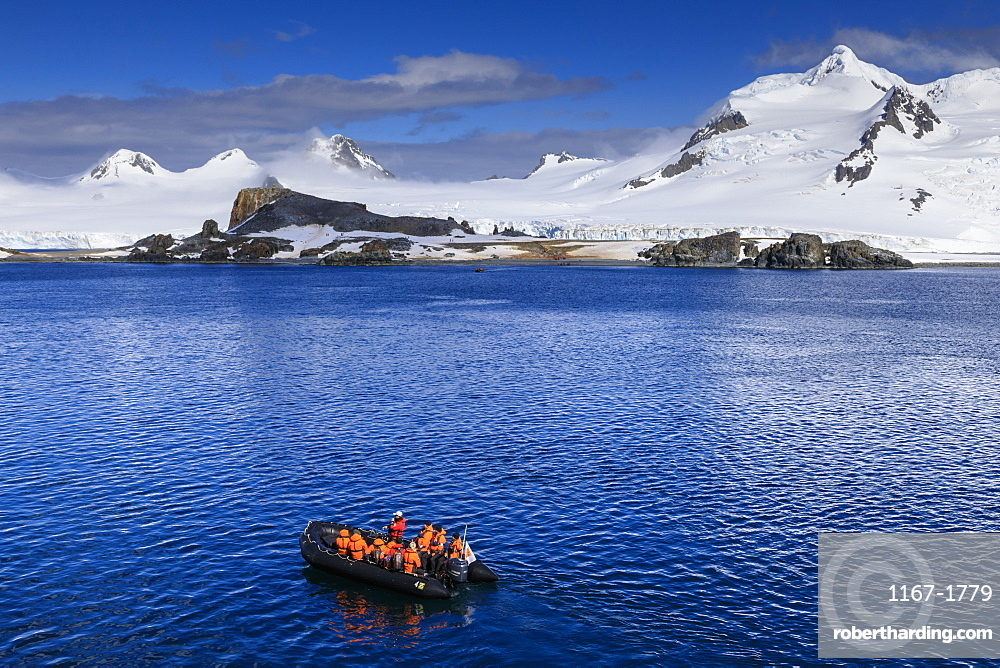 Zodiac boat, expedition tourists, landing beach, Half Moon Island, Livingston Island view, South Shetland Islands, Antarctica, Polar Regions