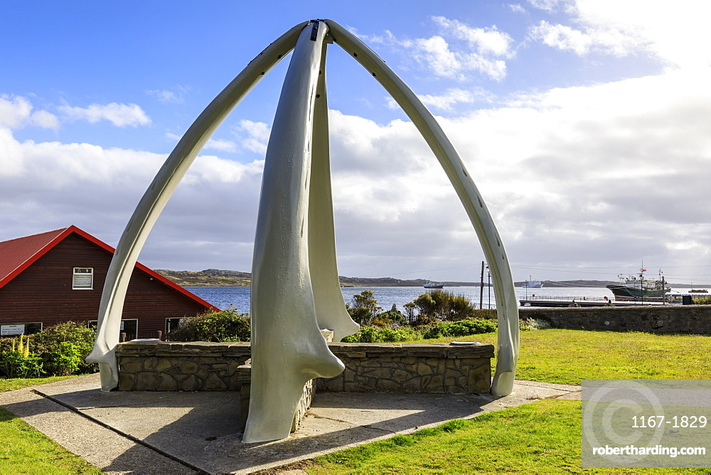 Restored Whalebone Arch, ships and the Narrows waterfront, Stanley Harbour, Port Stanley, Falkland Islands, South America