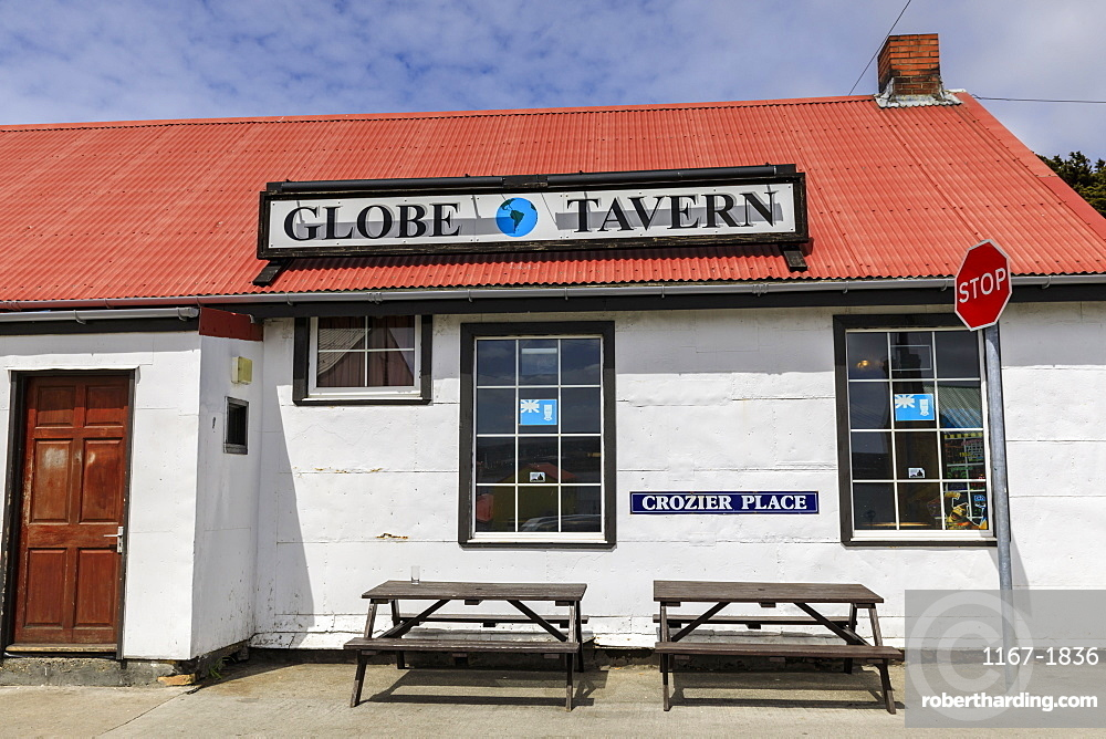 Stop sign and Globe Tavern British Pub, picnic tables, Stanley, Port Stanley, Falkland Islands, South America