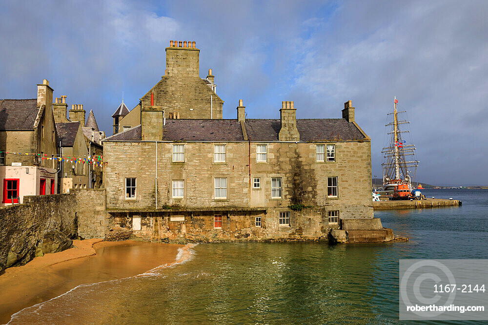 Beautiful waters of Bain's Beach, smugglers cove, historic buildings, Central Lerwick, Shetland Isles, Scotland, United Kingdom