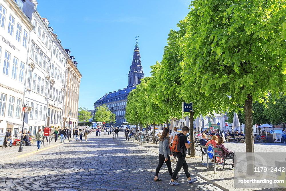 People walk in the pedestrian road towards Christiansborg Palace, Copenhagen, Denmark, Europe