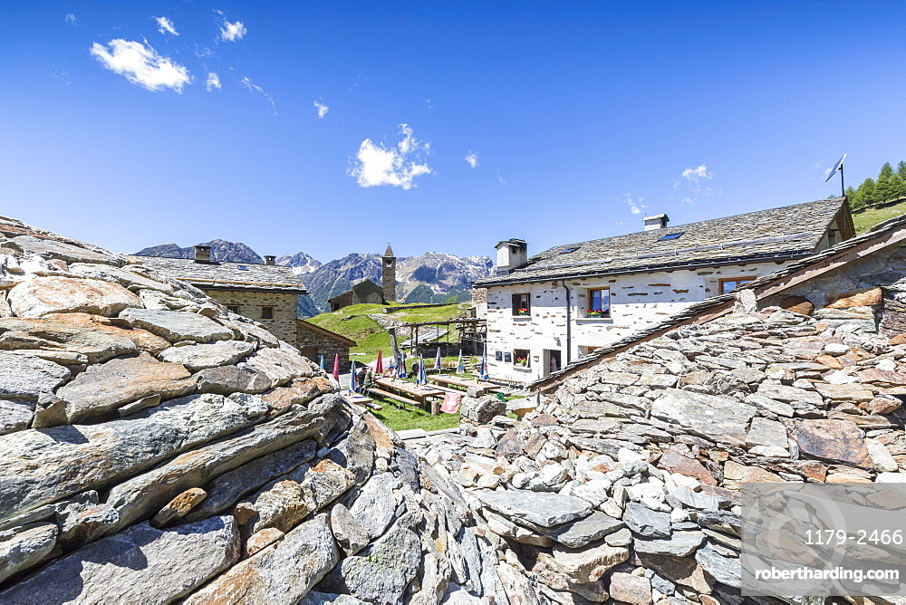 Mountain retreat and old stone caves called Crotto, San Romerio Alp, Brusio, Poschiavo Valley, Canton of Graubunden, Switzerland, Europe
