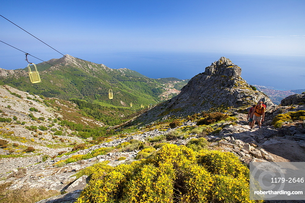 Hikers at cableway, Monte Capanne, Elba Island, Livorno Province, Tuscany, Italy, Europe