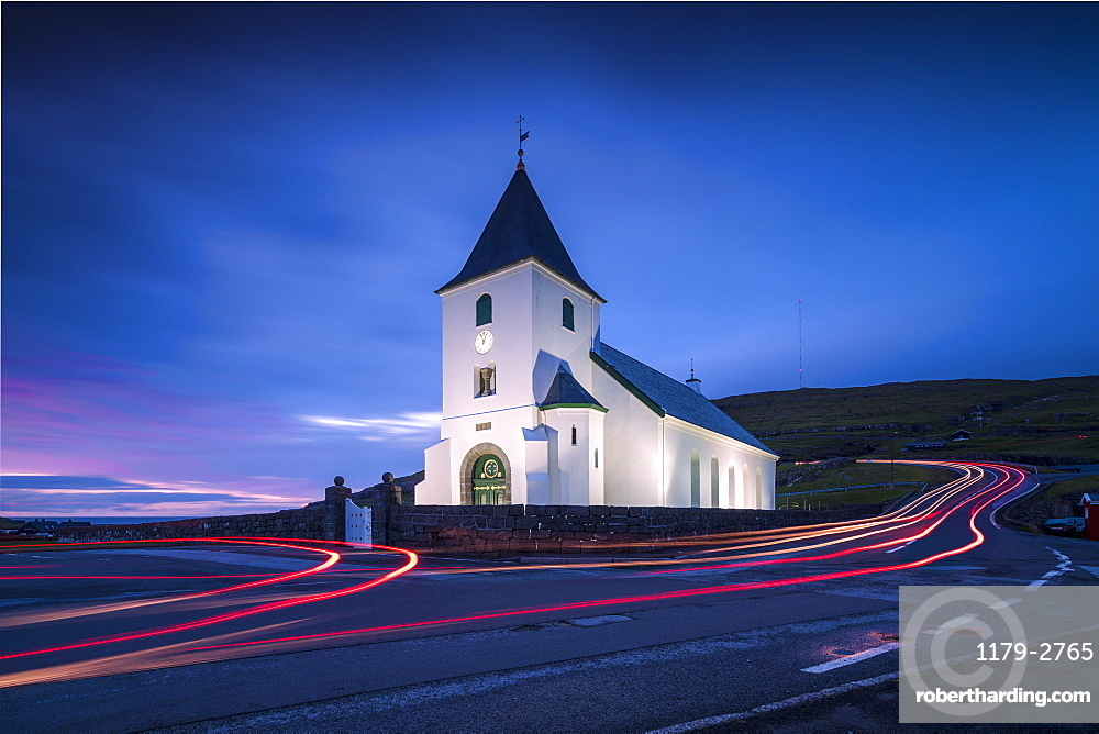 Lights of car trails at church of Eidi at dusk, Eysturoy Island, Faroe Islands, Denmark, Europe