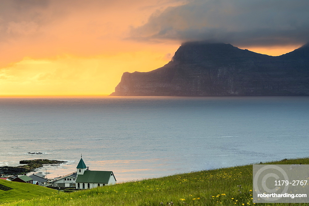 Church on the ocean shore towards Kalsoy Island, Gjogv, Eysturoy Island, Faroe Islands, Denmark, Europe