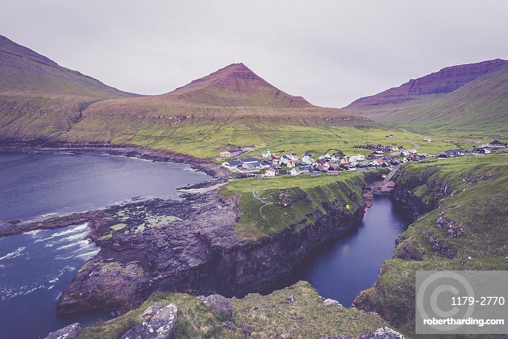 The village of Gjogv in between mountains and ocean, Eysturoy Island, Faroe Islands, Denmark, Europe