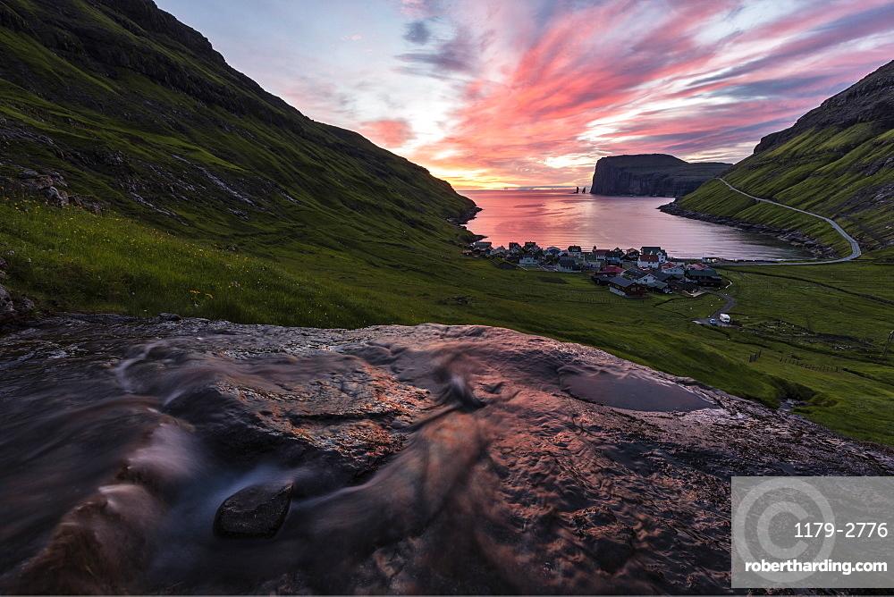 Water of creek flows on rocks, Tjornuvik, Sunda Municipality, Streymoy Island, Faroe Islands, Denmark, Europe