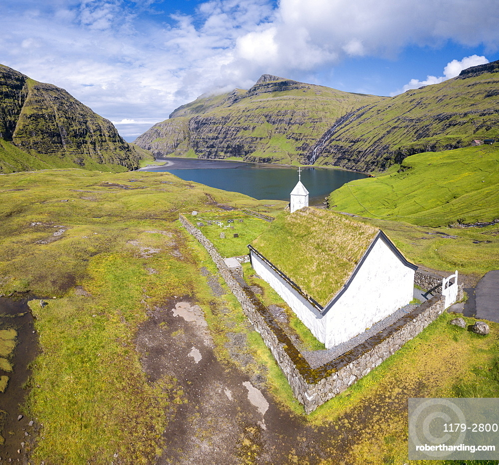 Elevated view of typical church in Saksun, Streymoy Island, Faroe Islands, Denmark, Europe (Drone)