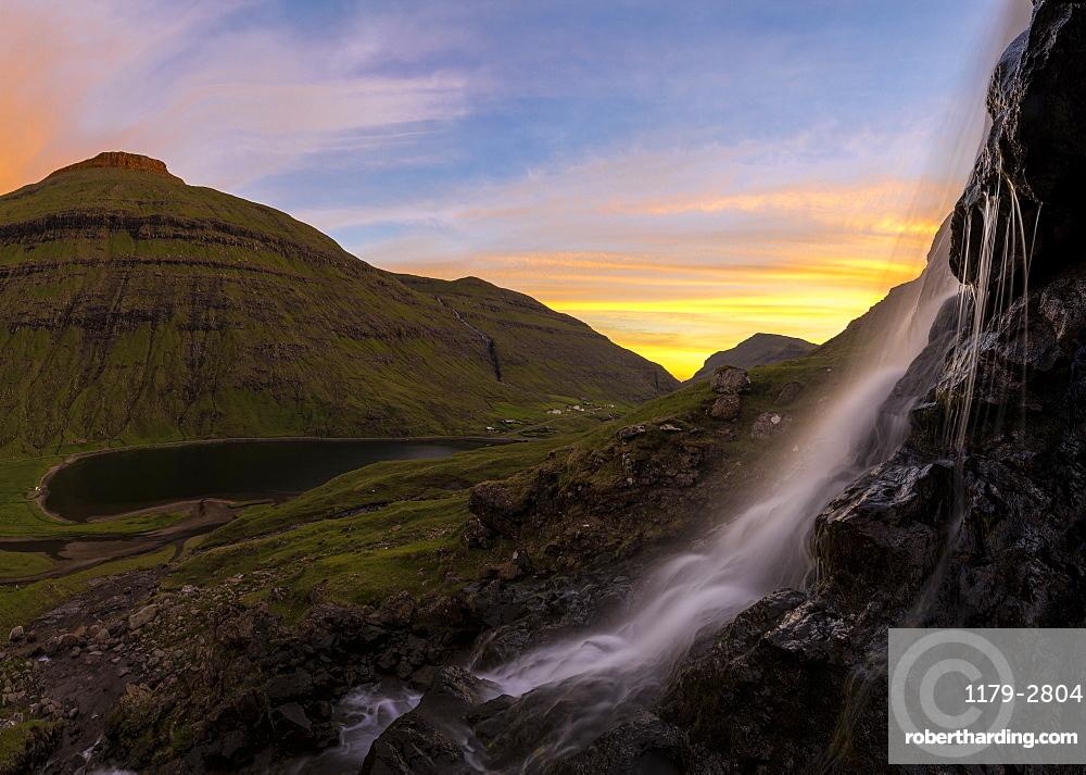 Panoramic of waterfall at sunset, Saksun, Streymoy Island, Faroe Islands, Denmark, Europe