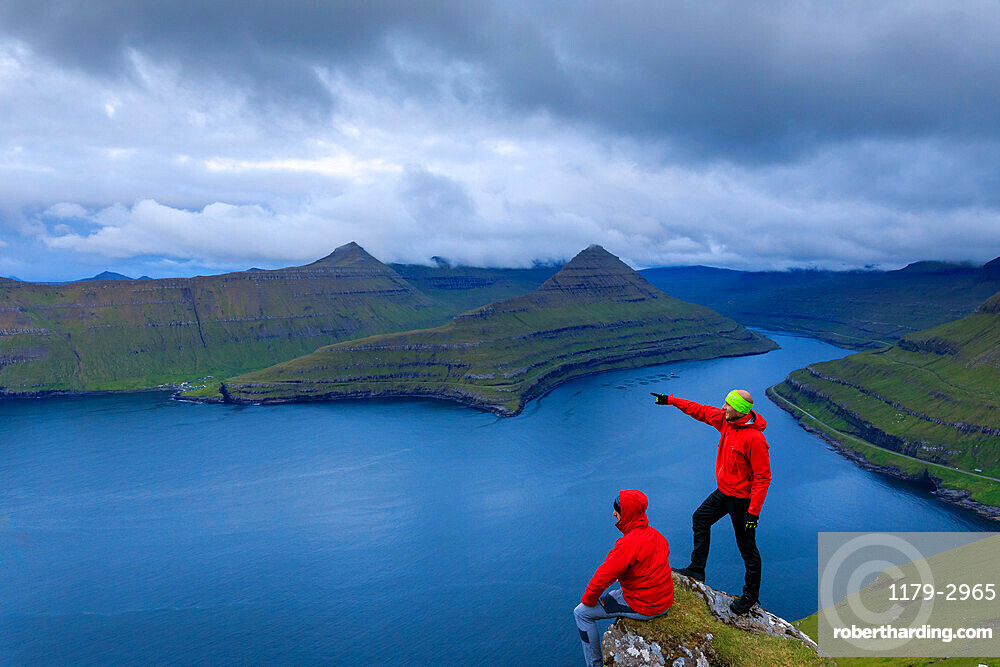 Hikers, Funningur fjord, Eysturoy Island, Faroe Islands, Denmark