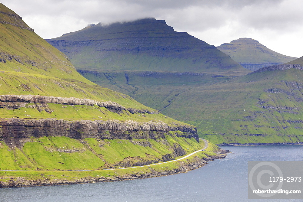 Road along mountain towards Funningur, Eysturoy Island, Faroe Islands, Denmark, Europe