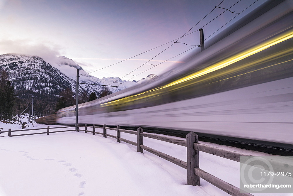 Bernina Express train in the snowy landscape, Morteratsch, Engadine, Canton of Graubunden, Switzerland, Europe