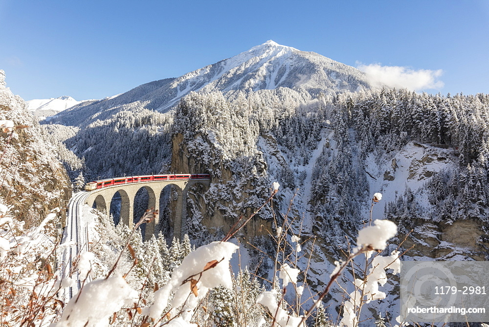 Bernina Express train on Landwasser Viadukt, UNESCO World Heritage Site, Filisur, Albula Valley, Canton of Graubunden, Switzerland, Europe