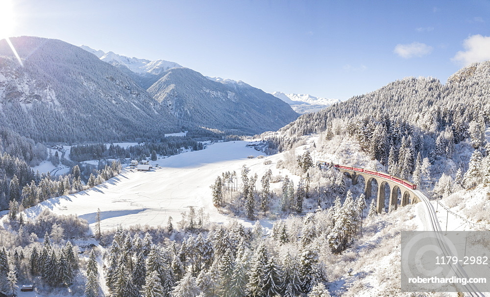 Panoramic of Bernina Express train on Landwasser Viadukt, UNESCO World Heritage Site, Filisur, Albula Valley, Canton of Graubunden, Switzerland, Europe (Drone)