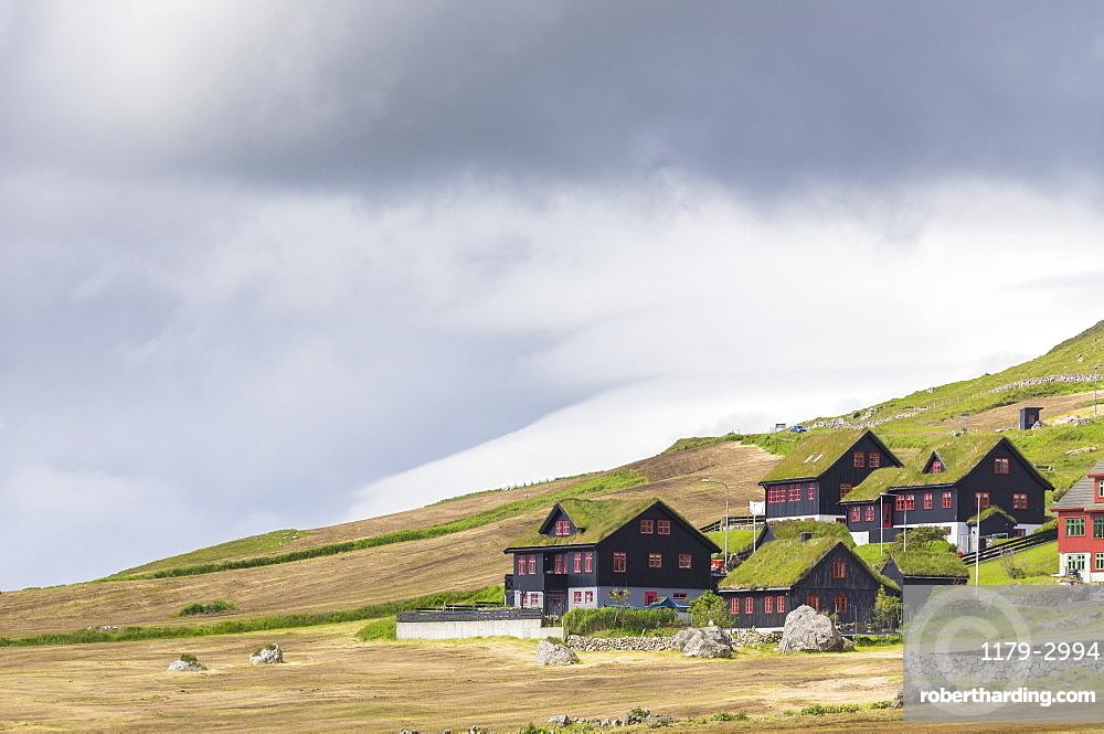 Traditional houses with grass (turf) roof, Kirkjubour, Streymoy island, Faroe Islands, Denmark, Europe