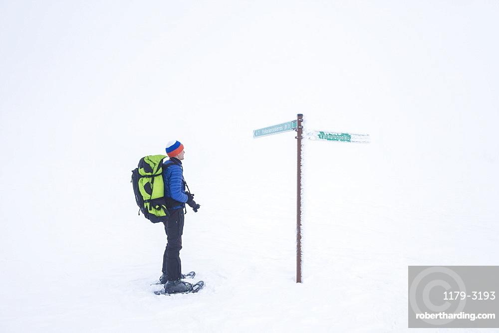 Photographer on snowshoes, Pallas-Yllastunturi National Park, Muonio, Lapland, Finland, Europe