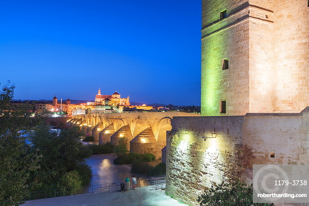 Dusk lights on Puerta del Puente and Calahorra tower (Torre de la Calahorra), gate of Islamic origin, Cordoba, UNESCO World Heritage Site, Andalusia, Spain, Europe