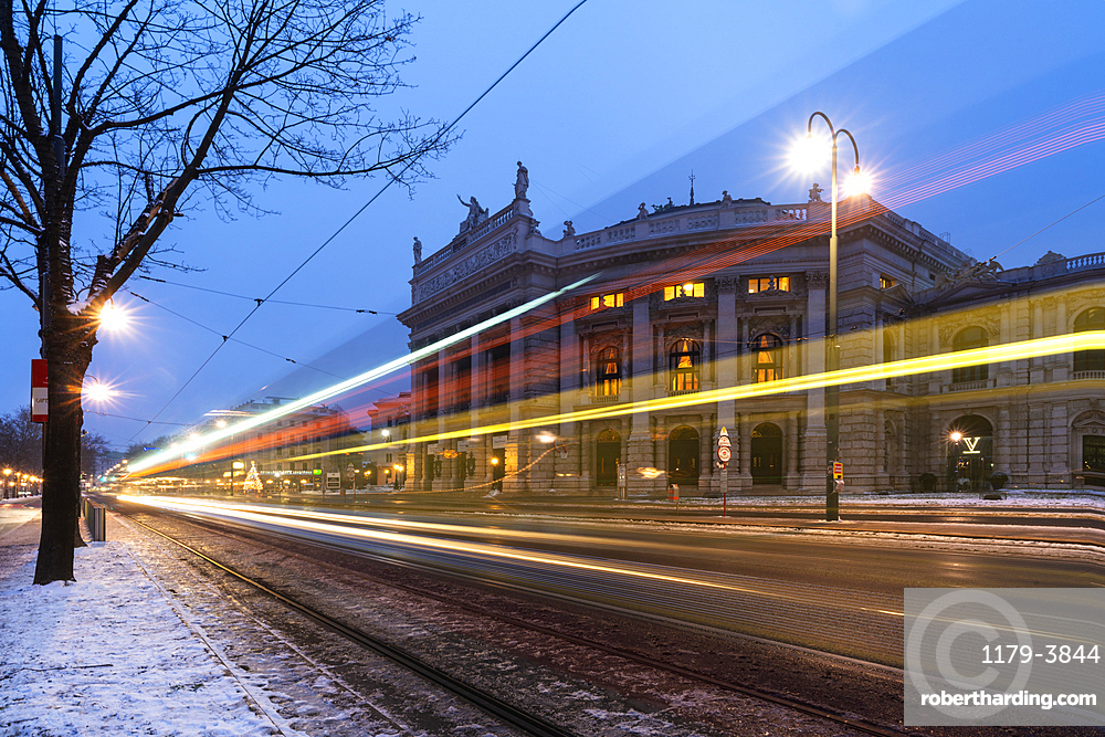 Lights of car trails on the icy road beside the famous Burgtheater, Austrian National Theatre, Vienna