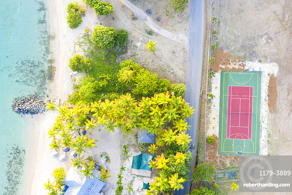 Aerial by drone of Sport court beside a tropical sand beach from above, Morris Bay, Old Road, Antigua, Antigua and Barbuda, Leeward Islands, West Indies, Caribbean, Central America