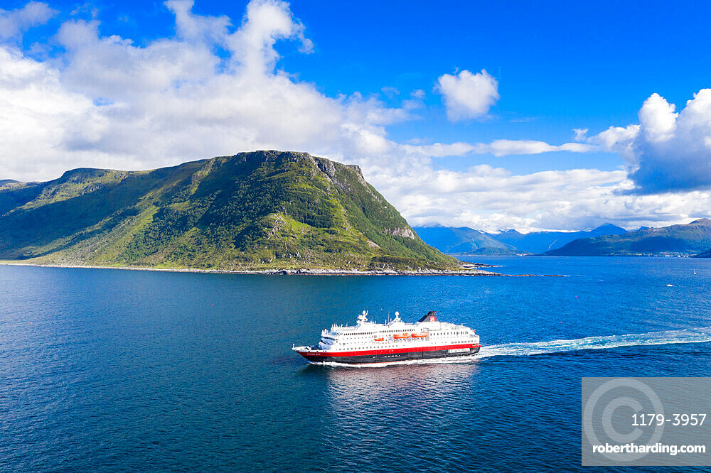 Aerial view of Hurtigruten during a daily trip along the fjord, Alesund, More og Romsdal county, Norway (drone)