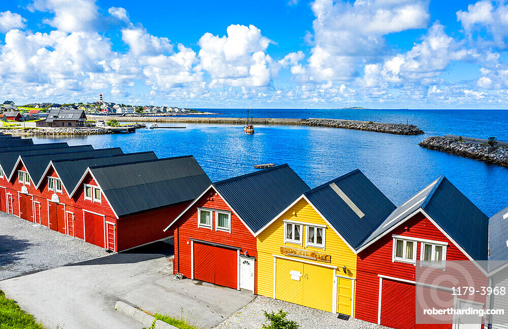 Traditional wood houses waterfront along the fjord, Alnes, Godoya Island, Alesund, More og Romsdal County, Norway (drone)