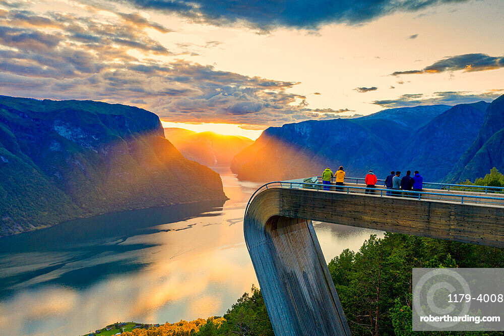 People admiring sunset from Stegastein viewpoint, aerial view, Aurlandsfjord, Sogn og Fjordane county, Norway (drone)