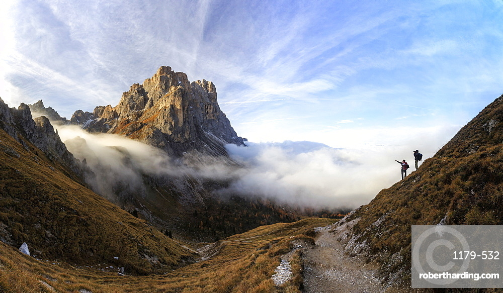 Hikers admire the peaks of Forcella De Furcia at sunrise, Funes Valley, South Tyrol, Dolomites, Italy, Europe