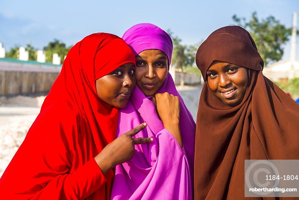 Colourfully dressed Muslim women in the coastal town of Berbera, Somaliland, Somalia, Africa