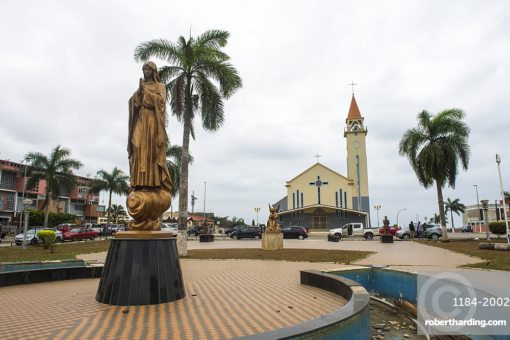 Statue of Mary in front of the Tchiowa Church in the town centre of Cabinda, Angola, Africa