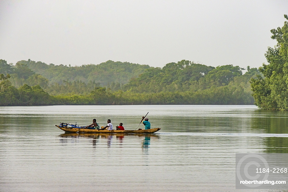 Locals in a canoe on a river east of Buchanan, Liberia, West Africa, Africa