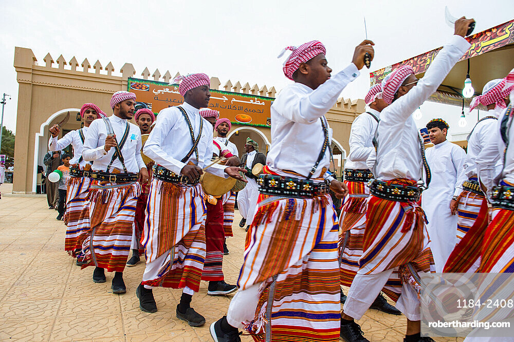 Traditional dressed local tribesmen dancing at the Al Janadriyah Festival, Riyadh, Saudi Arabia, Middle East