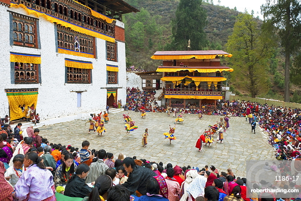 Crowds watching the dancers at the Paro festival, Paro, Bhutan, Asia