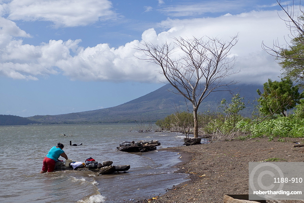 Washer woman on lake at Ometepe Island, Nicaragua, Central America