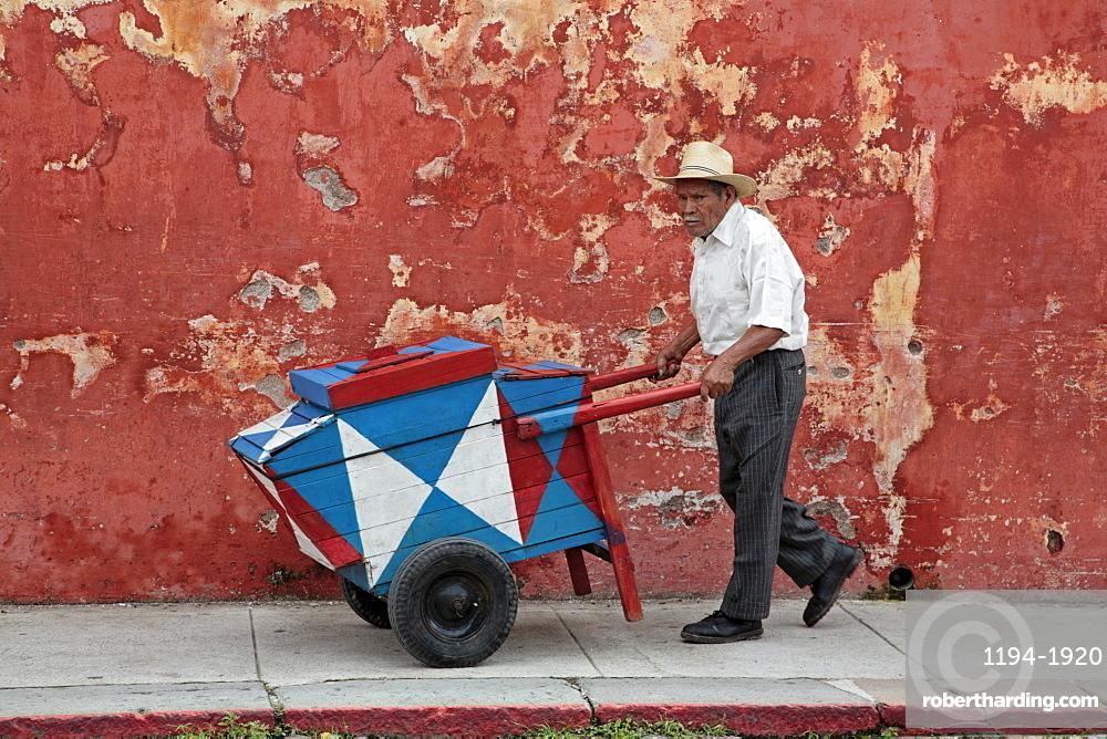 Guatemala street scene. cream seller. Antigu