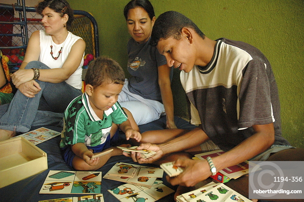 Colombia father relating nicely to his son at a day care and child stimulation center run by dni (international defence of children) in barrancabermeja