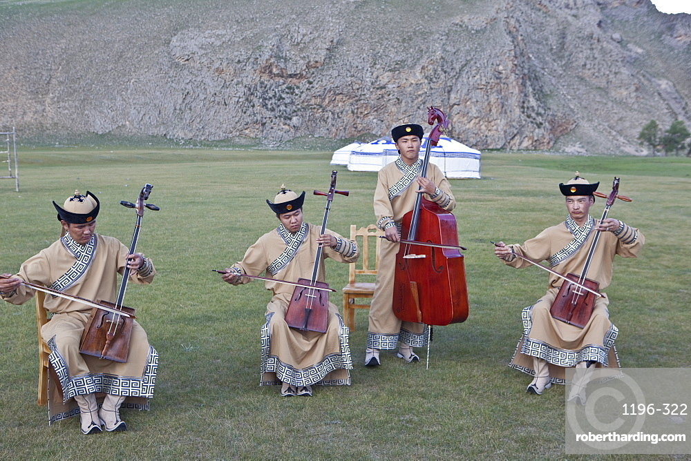 Local band play Mongolia's National instrument, the Morin khuur (horse head fiddle) and perform Khoomi, throat singing, Bunkhan, Mongolia, Central Asia, Asia