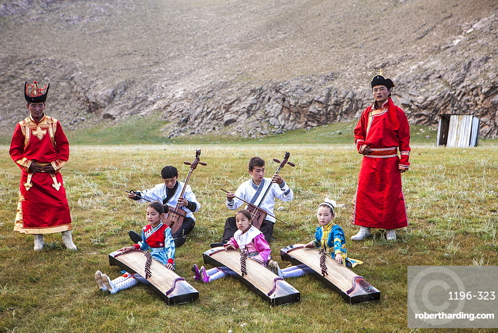 Boys playing Morin khuur (stringed instrument) (horse-head-violin) while young girls play Yatga-Yatuga (stringed instrument), Bunkhan, Mongolia, Central Asia, Asia