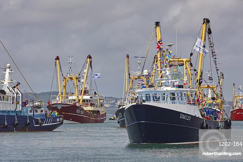 Trawlers in the annual trawler race, off Brixham, in Torbay, Devon, Great Britain.