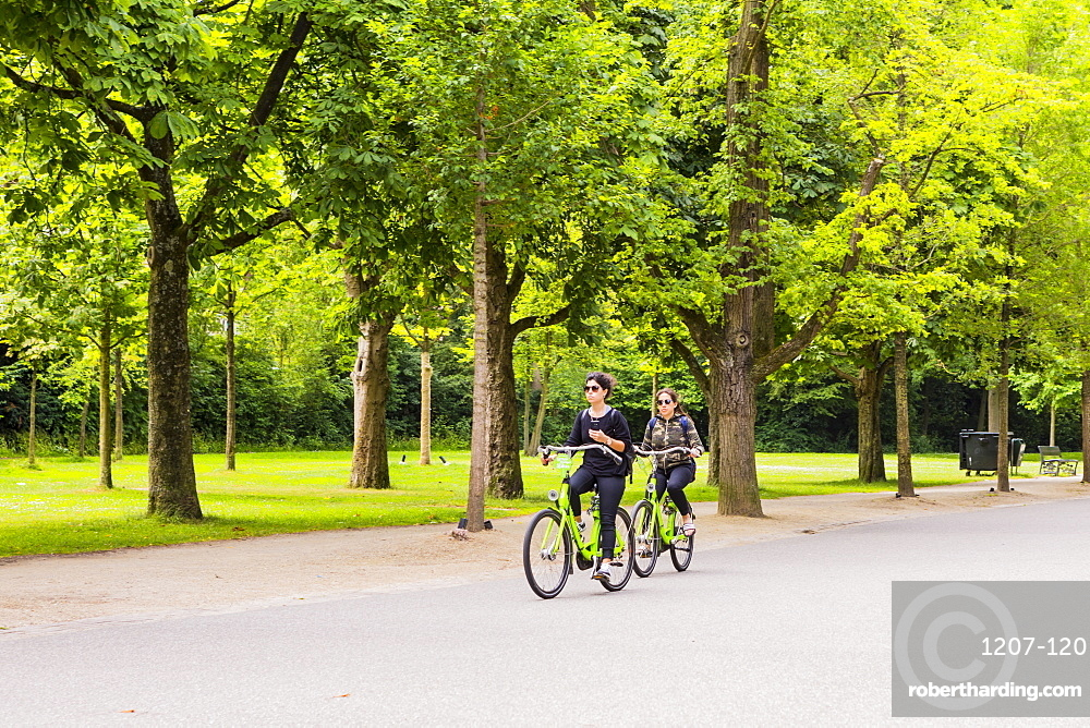 People cycling in Vondelpark, Amsterdam, Netherlands, Europe