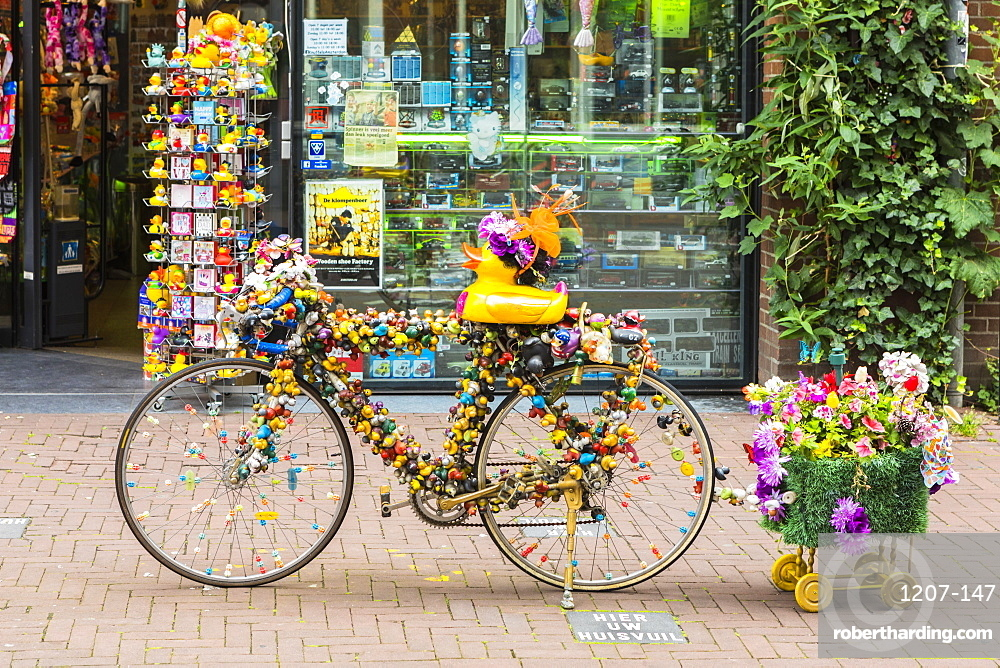 A bicycle outside a shop in Amsterdam, Netherlands, Europe