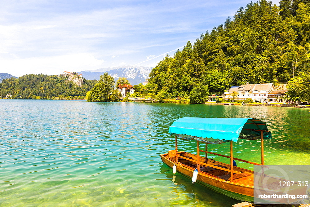 A boat on Lake Bled with Bled Castle in the background, Lake Bled, Slovenia, Europe