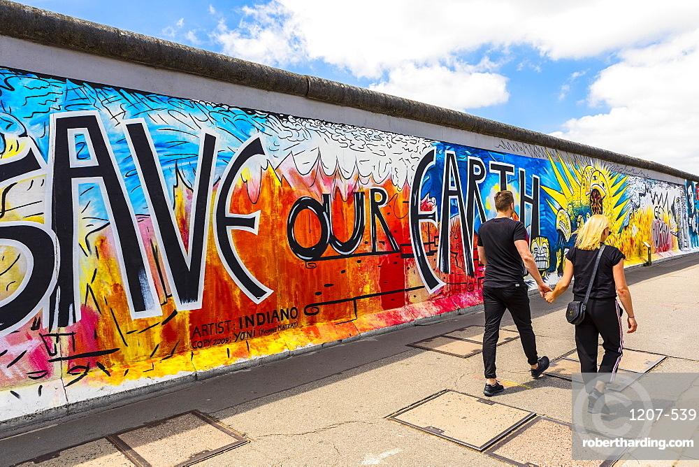 People walking in front of the Berlin Wall, Berlin, Germany, Europe